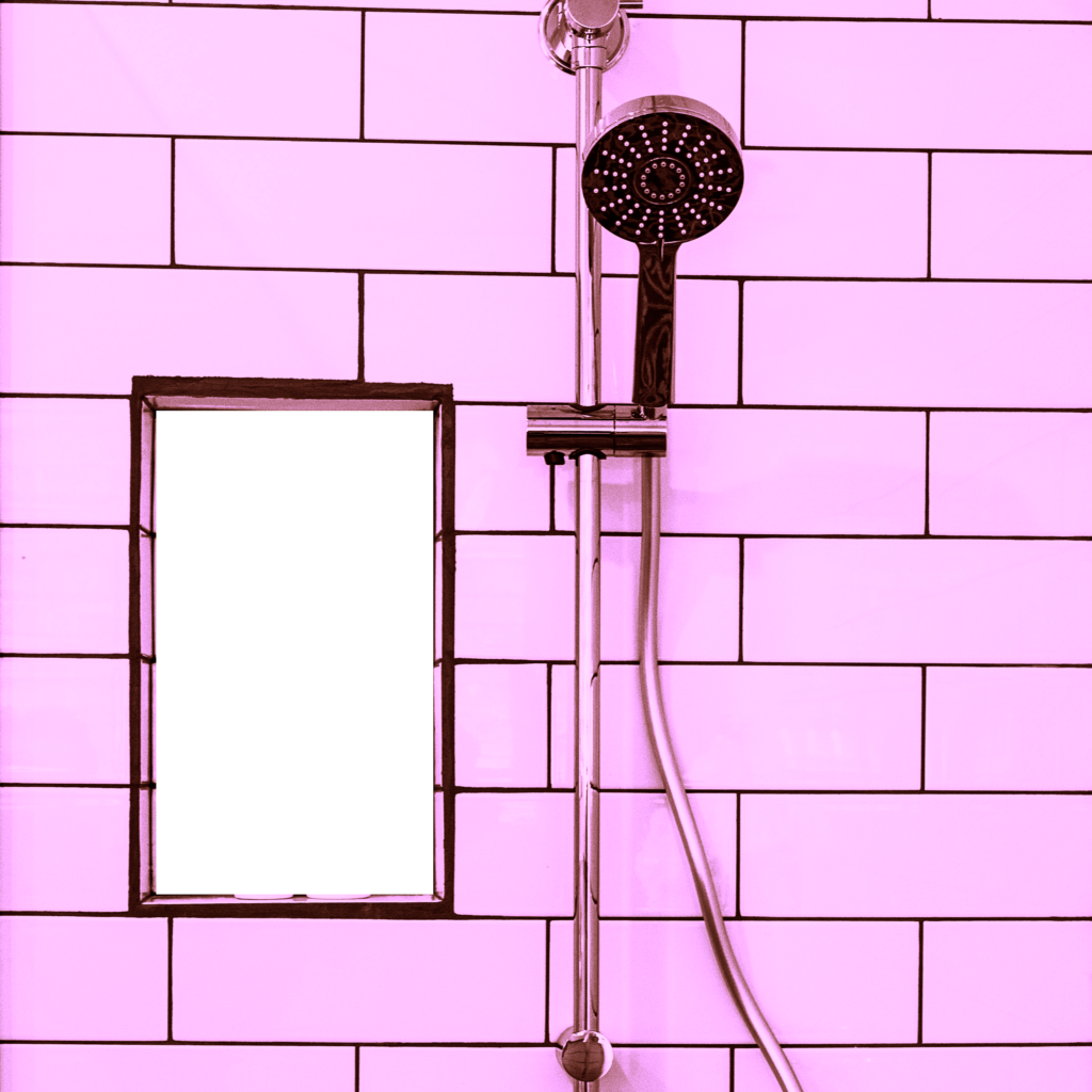 shower head on pink tiles
